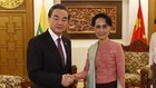 China's Foreign Minister Wang Yi (L) and Myanmar's State Counsellor Aung San Suu Kyi (Source Xinhua)