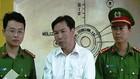 嫌犯陶晉強(中)因向峴港市人委會主席黃德詩發送威脅殺人短信行徑而被捕。(圖源:VNM)