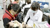 Parents should take their children to hospital for vaccination against measles (PHoto: SGGP)