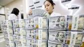 Theo Ngân hàng Trung ương Hàn Quốc, quy mô của các quỹ đầu tư và tiền gửi ở nước này đã đạt mức cao kỷ lục. Ảnh: EPA-EFE