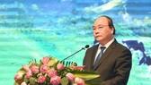 政府總理阮春福在2017年山羅省投資促進會議上發表講話。(圖源:越通社)