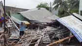 12號颱風登陸慶和省4小時後逐漸消失,到處一片狼藉。(圖源:文玉)