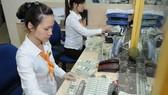 僑匯收入促進本市的生產經營發展。(示意圖源:越通社)