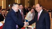 阮春福總理與企業代表交流。(圖源:統一)