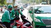 GrabCar網約車在本市接送乘客。(圖源:獨立)