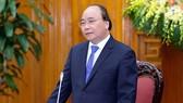 政府總理阮春福在會議上發表講話。(圖源:寶娟)