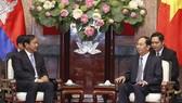國家主席陳大光接見柬埔寨高級部長、外交與國際合作部部長布拉索昆。(圖源:VNA)