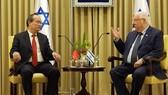 市委書記阮善仁(左)在耶路撒冷市會見以色列總統魯文‧里夫林。(圖源:越通社)