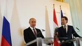 6月5日,在奧地利維也納總統府,俄羅斯總統普京(左)和奧地利總理庫爾茨出席新聞發佈會。(圖源:路透社)
