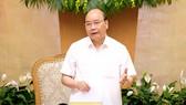 阮春福總理在會議上致詞。(圖源:光孝)