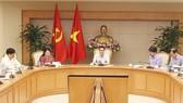 政府副總理、中央跨部門食品安全指委會主任武德膽(中)主持會議並發表講話。(圖源:VGP)