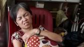 韋明梅疼痛難忍,正籌錢轉院。