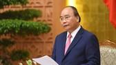 政府總理阮春福在會議上致詞。(圖源:光孝)