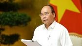 政府總理阮春福主持會議並發表重要講話。(圖源:光孝)