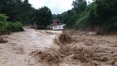 Flash flood swept away nine houses in Ky Son district, Nghe An on July 21 (Photo: SGGP)