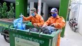 Thu gom rác phân loại tại nguồn ở quận 1, TPHCM                                     Ảnh: THÀNH TRÍ