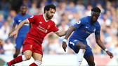 Mohamed Salah (trái) và Liverpool vẫn còn cơ hội tự quyết suất dự Champions League mùa tới. Ảnh: Getty Images