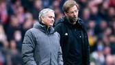 HLV Jurgen Klopp (phải) và Jose Mourinho dự báo sẽ có mùa giải căng thẳng. Ảnh: Getty Images