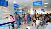 Bệnh nhân đăng ký khám bệnh tại một bệnh viện ở TPHCM