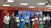 Các tác giải đoạt giải thưởng Báo chí về trẻ em. Ảnh: VIETNAM+