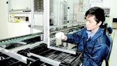 Sản xuất thiết bị điện tử viễn thông tại Công ty Greystone Dât Systems. ẢNh: CAO THĂNG