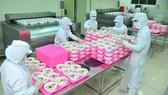 Kiểm tra chuyên ngành gây khó khăn cho doanh nghiệp chế biến thực phẩm. Ảnh: CAO THĂNG