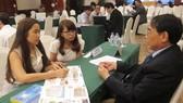 Các doanh nghiệp Thái Lan và doanh nghiệp Việt Nam trao đổi, giao lưu tại một hội thảo. Ảnh: TTXVN
