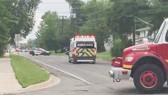 Xe cứu thương và cảnh sát được triển khai tại khu vực xảy ra vụ xả súng ở Fredericton, New Brunswick, Canada ngày 10-8. Ảnh: The Guardian