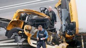 US school bus crash: one student, one teacher killed