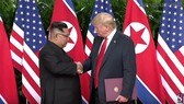 Trump, Kim sign agreementafter historic summit but few specifics