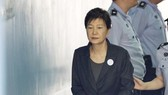 Court sentences ex-leader Park to 8 years in prison...