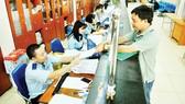 Hải quan giải quyết hồ sơ doanh nghiệp xuất nhập khẩu tại Cảng Cát Lái, TPHCM. Ảnh: CAO THĂNG