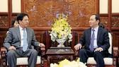Chủ tịch nước Trần Đại Quang và Đại sứ Trung Quốc Hồng Tiểu Dũng trong buổi tiếp. Ảnh: TTXVN