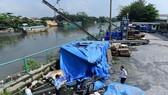 Bến thủy nội địa của Công ty TNHH ADC trên đường Nguyễn HữuTrí, huyện Bình Chánh, TP.HCM hết hạn cấp phép hoạt động, phải tạm ngưnghoạt động - Ảnh: QUANG ĐỊNH