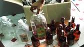 Tang vật của một vụ làm rượu giả bằng hoá chất không an toàn