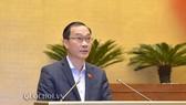Ông Vũ Hồng Thanh, Chủ nhiệm Ủy ban Kinh tế của Quốc hội thay mặt Ủy ban Thường vụ Quốc hội (UBTVQH) trình bày Báo cáo giải trình, tiếp thu dự thảo Luật