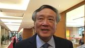 Chánh án Tòa án Nhân dân tối cao Nguyễn Hòa Bình trao đổi với báo chí sáng 13-11