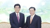 政府副總理王廷惠(右)會見吉林省委書記巴音朝魯。