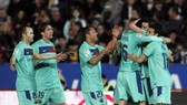 Barca stretch lead to seven points as Real held