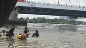 Nỗ lực tìm kiếm bé trai mất tích ở sông Sài Gòn