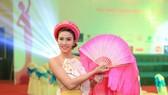 Cựu chủ công Lê Hương Giang giờ đây dịu dàng trong các cuộc thi sắc đẹp. Ảnh: NVCC