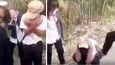 """Nam học sinh bị nhóm nữ vây đánh """"hội đồng"""" và dùng điện thoại quay video clip lại. Ảnh cắt từ video clip"""