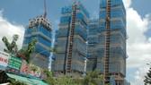 Sóng ngầm bán tháo các dự án bất động sản