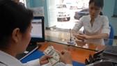 NHNN giao Vụ Chính sách tiền tệ điều hành tỷ giá