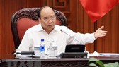 Prime Minister Nguyen Xuan Phuc addresses the meeting (Photo: VNA)