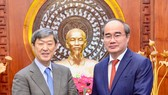 Secretary of the HCM City Party's Committee Nguyen Thien Nhan (R) and JICA President Shinichi Kitaoka  (Photo: hcmcpv.org.vn)