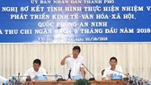 Chairman of the HCM City People's Committee Nguyen Thanh Phong (centre) speaks at the meeting on the city's socio-economic performance on October 1 (Photo: VNA)