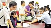 Thí sinh tự do đăng ký dự thi tại Cơ quan Đại diện Bộ GD-ĐT TPHCM. Ảnh tư liệu