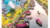 Chợ hoa xuân trên bến Bình Đông, quận 8, TPHCM. Ảnh: MAI NGUYỄN - NAM HUÊ
