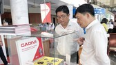 "Products are showcased at the conference reviewing the campaign ""Vietnamese use Vietnamese goods"" in HCM City on April 13 (Photo: VNA)"